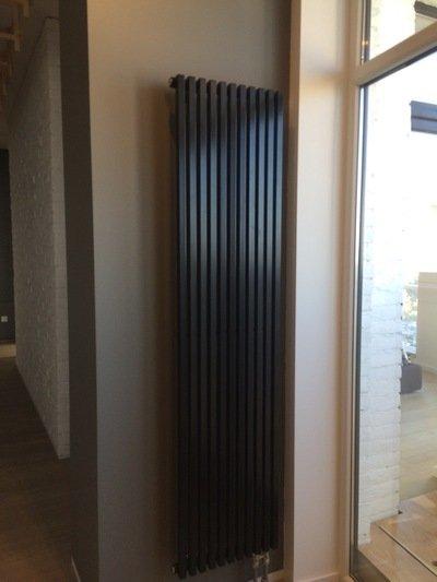 Вертикальные радиаторы отопления – преимущества и разновидности
